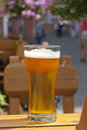 Glass of beer in restaurant on the table outdoor sun Royalty Free Stock Photos