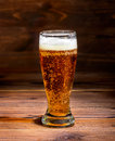 glass beer on rustic table wood background Royalty Free Stock Photo