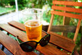 Glass of beer and sunglasses Royalty Free Stock Photo