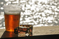 Glass of beer and sunglasses Royalty Free Stock Photos