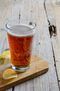Glass beer on wood background Royalty Free Stock Photo