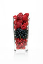 Glass with berries cup on a white background Royalty Free Stock Images