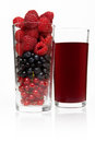 Glass with berries and juice cup on a white background Royalty Free Stock Photography