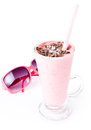 Glass of blended fruit strawberry smoothie with sunglasses on wh tasty creamy yoghurt and chocolate Stock Photo