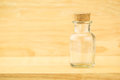 Glass bottle with cork on wood table and blur wooden wall, Copy Royalty Free Stock Photo