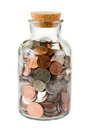 Glass bottle full of coins Royalty Free Stock Photo