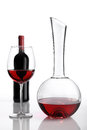 Glass and bottle of red wine decanter on white background Stock Images