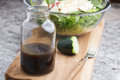 a glass bottle with salad dressing consisting of balsamic vinegar, honey and olive oil Royalty Free Stock Photo