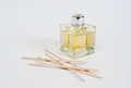 Glass bottle scented oil reeds Royalty Free Stock Photos
