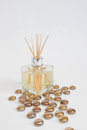 Glass bottle scented oil reeds gold beads scattered Stock Image