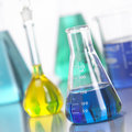 Glass Bottles in Lab with colored liquid-4 Stock Photos