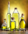 Glass bottles of olive oil and few berries. Royalty Free Stock Photo
