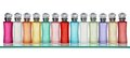 Glass bottles of perfume in a row on shelf Royalty Free Stock Photos