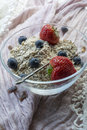 Glass bowl with cereals, strawberries and blueberries Royalty Free Stock Photo