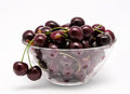 A glass bowl full with sweet cherries isolated on white background Royalty Free Stock Images