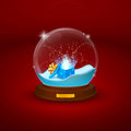 Glass bowl statuette with snow and open gift inside flickering image of a ball figurines holiday on red background Royalty Free Stock Images