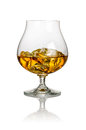 A glass of brandy on white background Stock Photography
