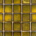 Glass brick tile texture yellow mosaic of wall squares background Royalty Free Stock Photo