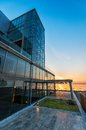 Glass building exterior at sunset Royalty Free Stock Photo