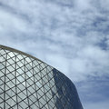 Glass building rounded modern against blue sky Royalty Free Stock Image