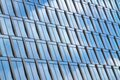 GLASS BUILDING WITH WINDOWS AN REFLECTIONS OF SKY AN CLOUDS Royalty Free Stock Photo