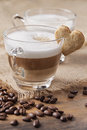 Glass of cappuccino with heart cookie Royalty Free Stock Photos