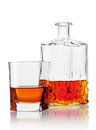 Glass and carafe of cognac isolated on white background Royalty Free Stock Photos