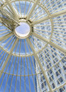 Glass ceiling and glass windows domed roof over looking tower block building in london with rows of Royalty Free Stock Photos