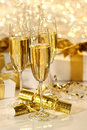 Glass of champagne against sparkle background Royalty Free Stock Photo