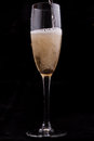 Glass champagne black background Stock Photos