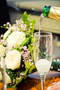 Glass of champagne with bouquet Royalty Free Stock Photography