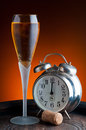 Glass champagne old watch showing twelve oâ clock Royalty Free Stock Photo