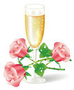 Glass of champagne with pink roses Stock Photography