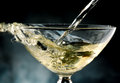 Glass of champagne poured in rivers to celebrate Stock Photos
