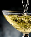 Glass of champagne poured in rivers to celebrate Royalty Free Stock Photo