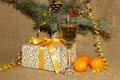 A glass of champagne tangerines and present for the new year filled with prepared Stock Images