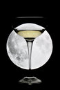 Glass of champagne under a full moon Royalty Free Stock Photo