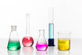 Glass in a chemical laboratory filled with colored liquid during Royalty Free Stock Photo