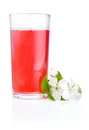Glass of cherry juice and flowers Royalty Free Stock Photo