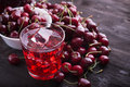 Glass of cherry juice Royalty Free Stock Photo