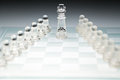 Glass chess board and the king on top Stock Photos