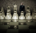 Glass chess board - We are puppets, Businessman of the king on the chessboard Royalty Free Stock Photo