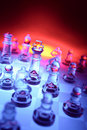 Glass chess and color backdrop Royalty Free Stock Photography