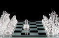 Glass chess and the first move Royalty Free Stock Photo