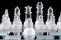Glass chess pawn on chess board Royalty Free Stock Photography