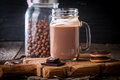 Glass of chocolate milkshake for breakfast on wooden table Royalty Free Stock Photography