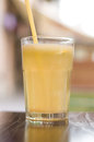 Glass of coffee with orange straw Royalty Free Stock Images