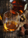 Glass of cognac and chocolate truffles Royalty Free Stock Photos