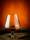 Glass of cognac and cigar Stock Images