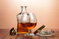 Glass of cognac with cigar on wooden table Royalty Free Stock Images
